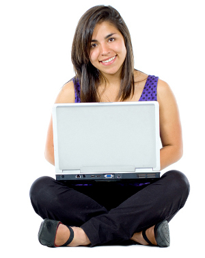 Casual girl on a laptop working on the floor over a white background